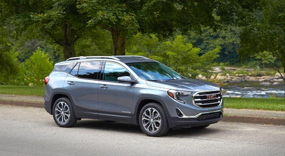 A gray 2018 GMC Terrain is parked in front of trees near Atlanta, GA.
