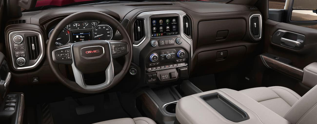 The dashboard and infotainment screen are shown in a 2020 GMC Sierra 2500.