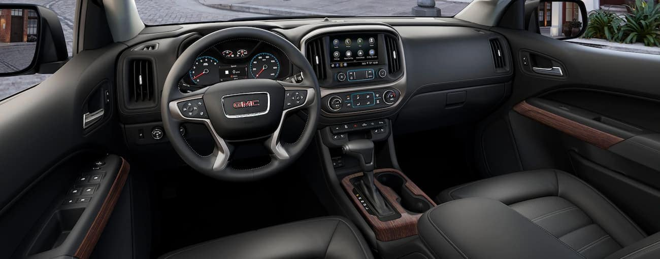 The black interior of a 2020 GMC Canyon is shown.