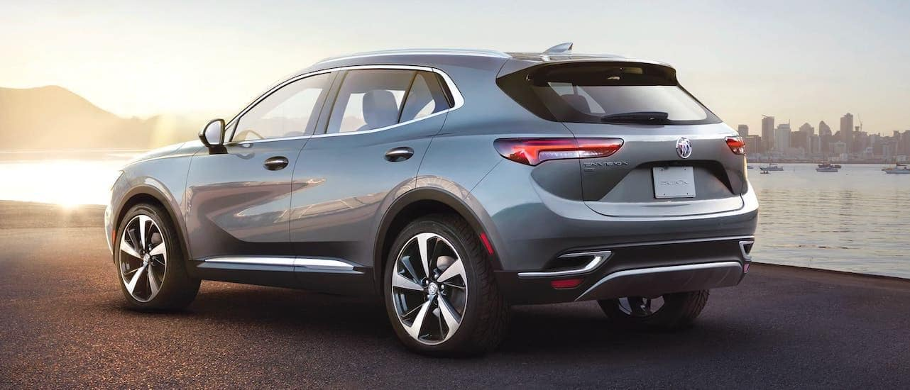 A silver 2021 Buick Envision is shown from the rear after winning the 2021 Buick Envision vs 2021 Acura RDX comparison.