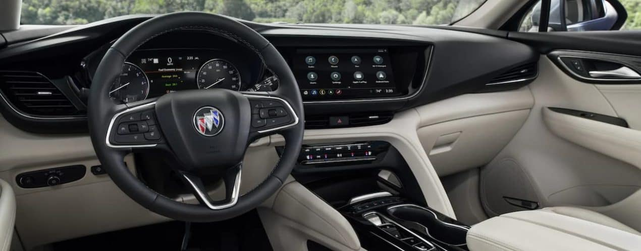 The dashboard and screen in a 2021 Buick Envision are shown.