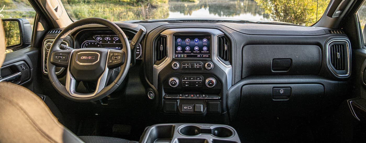 The gray interior and dashboard of a 2021 GMC Sierra Elevation is shown.