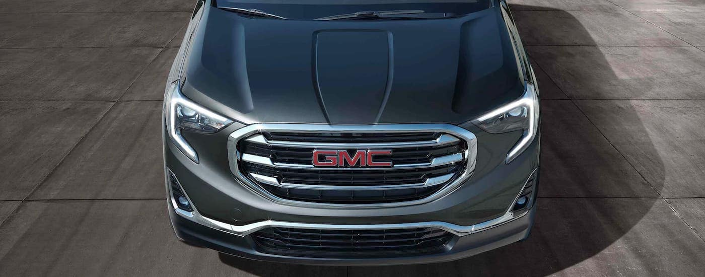 The front of a gray 2021 GMC Terrain is shown from a high angle.