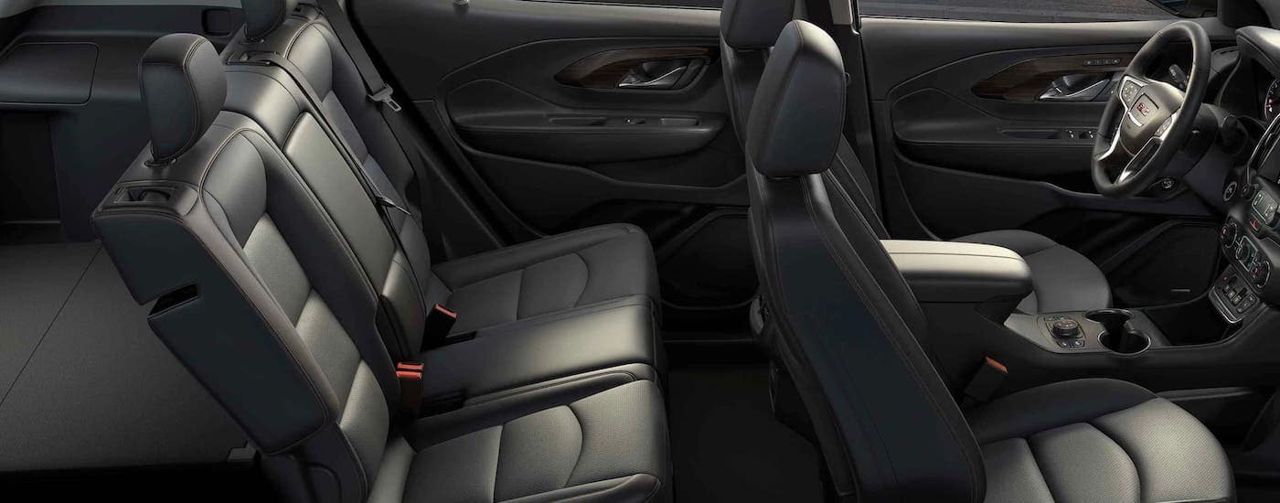 The black interior seats of a 2021 GMC Terrain are shown from the side.