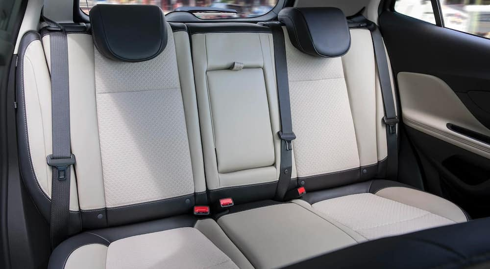 The white and black rear seats are shown in a 2021 Buick Encore.