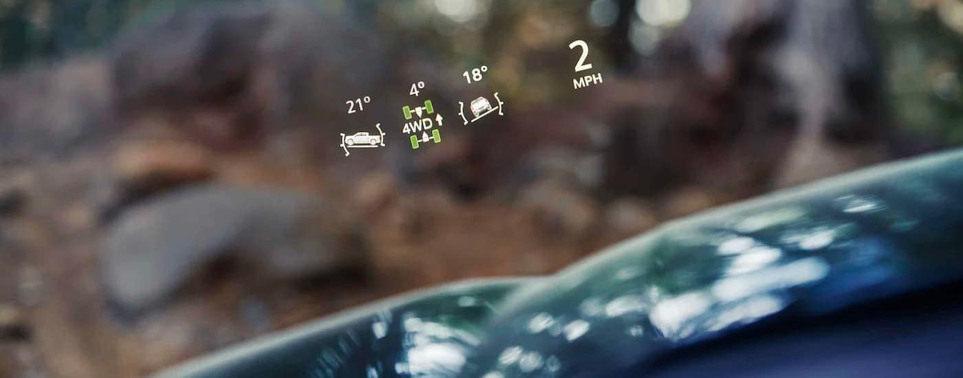 A close up shows the heads up display on a 2021 GMC Sierra 1500.