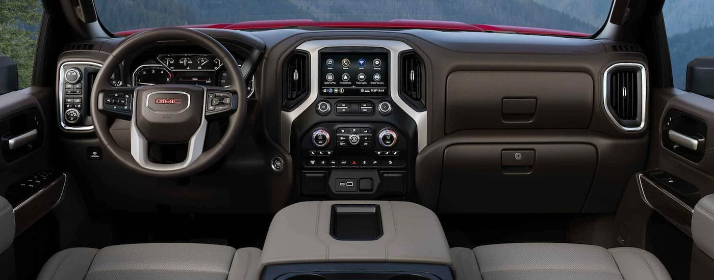 The black interior and infotainment system is shown on a 2021 GMC Sierra 2500 HD.
