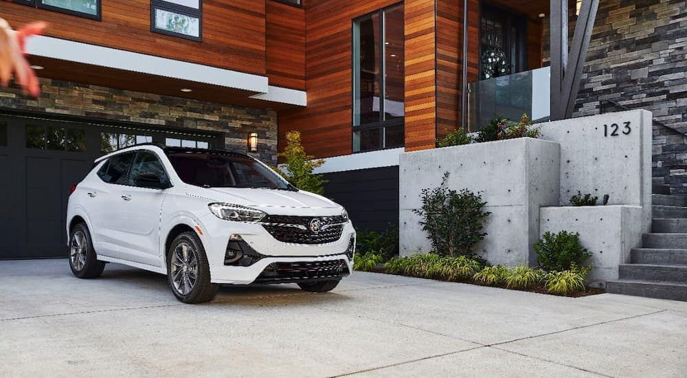A white 2021 Buick Encore GX is parked in a driveway after leaving a Buick GMC dealer near you.