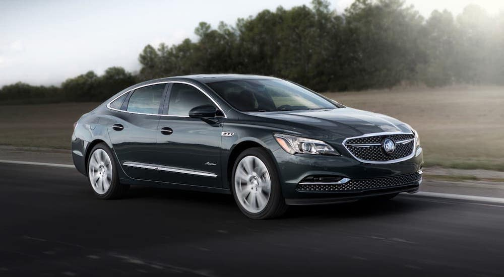 A popular used Buick in Atlanta, a black 2019 Buick LaCross Avenir, is driving on a highway.