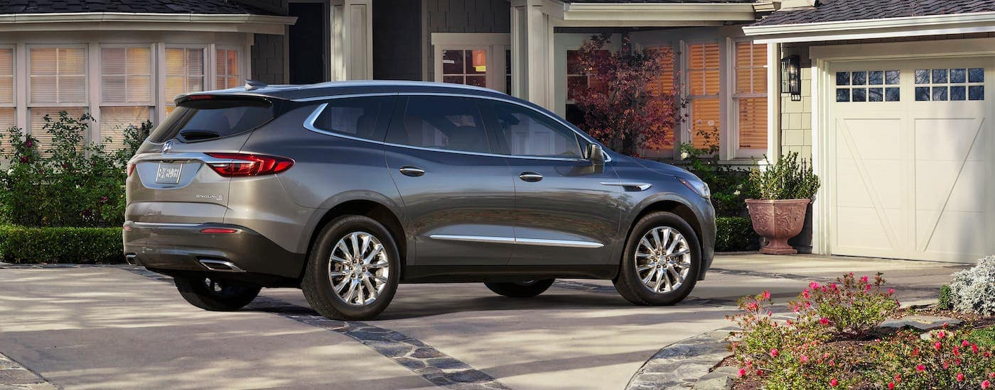 A gray 2019 Buick Enclave is parked in a driveway.