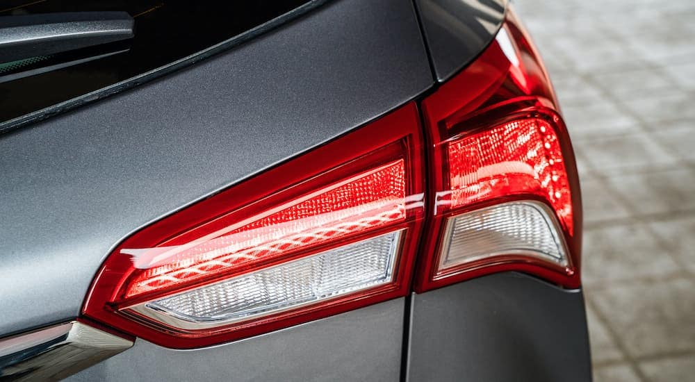 A close up shows the passenger side tail light of a gray 2019 Buick Envision.