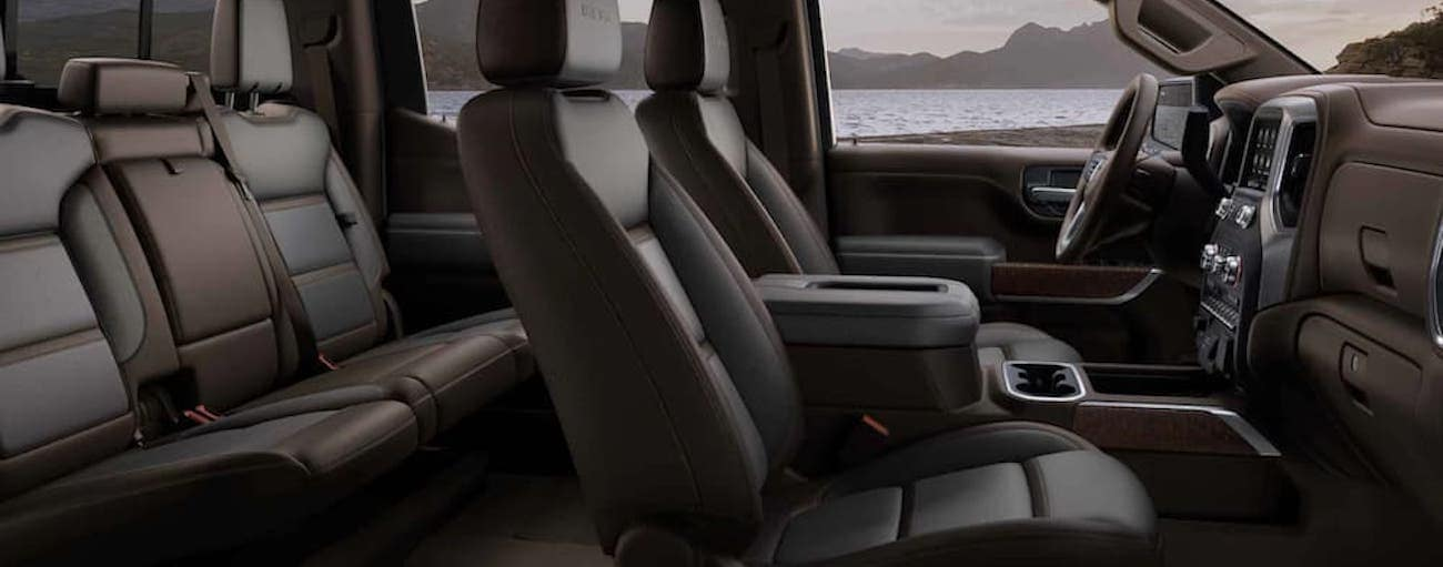 The black interior of a 2021 GMC Sierra 1500 is shown from the side.