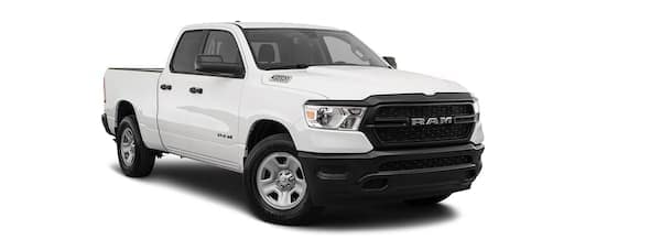 A white 2021 Ram 1500 is angled right.