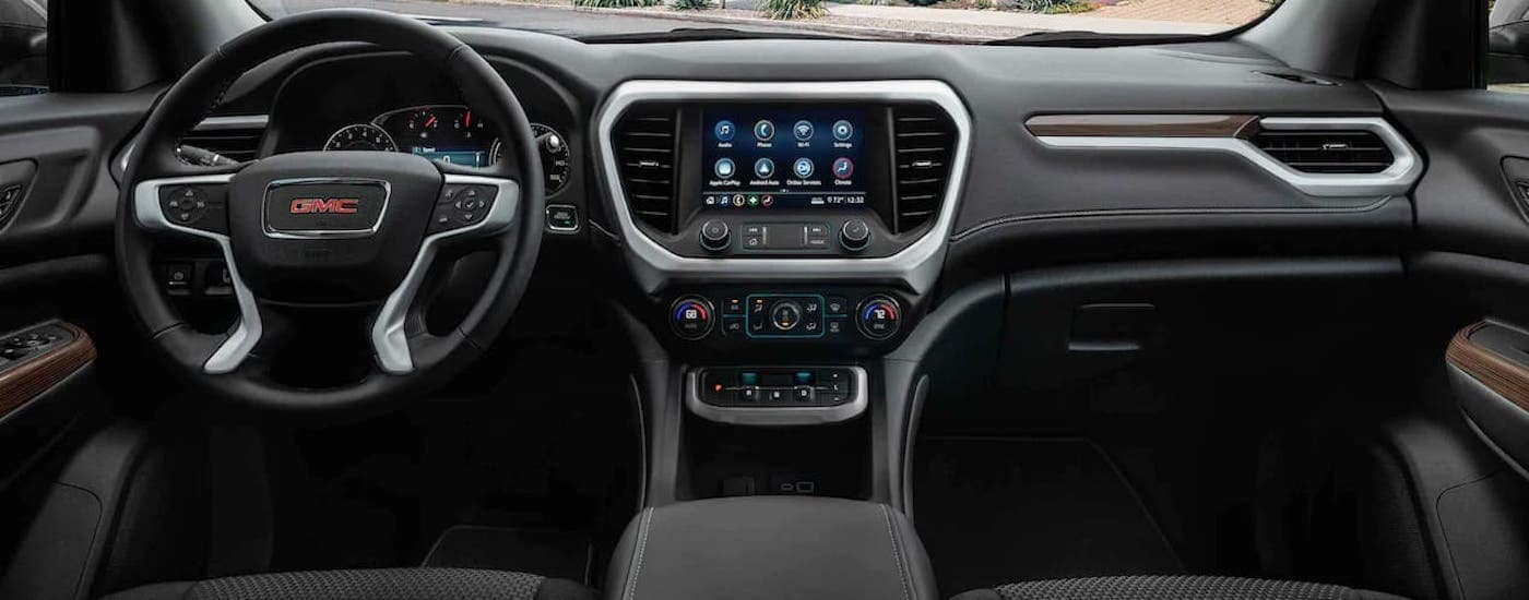 The black dashboard in a 2021 GMC Acadia is shown.