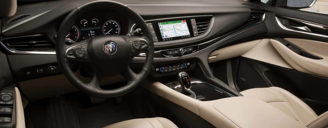 The brown and tan interior in a 2021 Buick Enclave is shown.