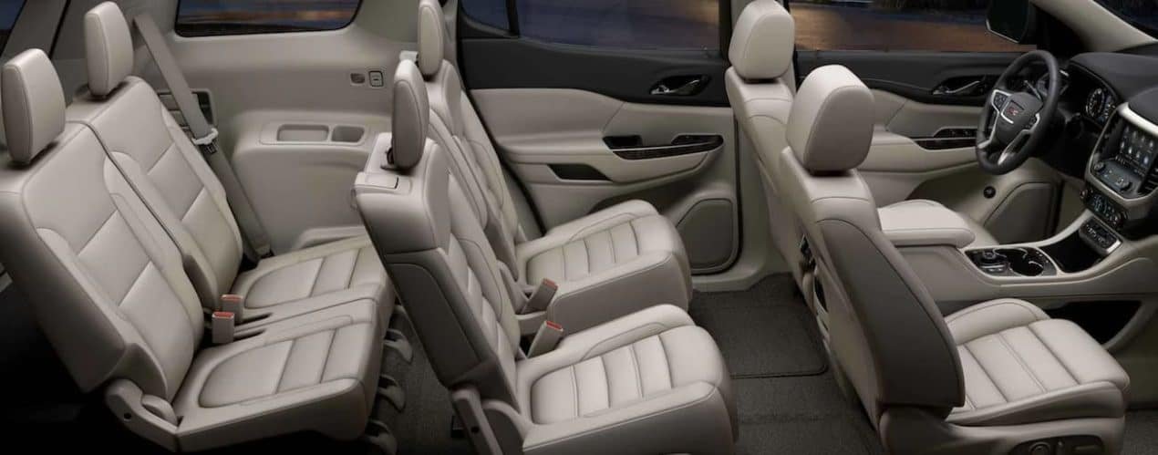 The beige interior of a 2021 GMC Acadia is shown from the side.