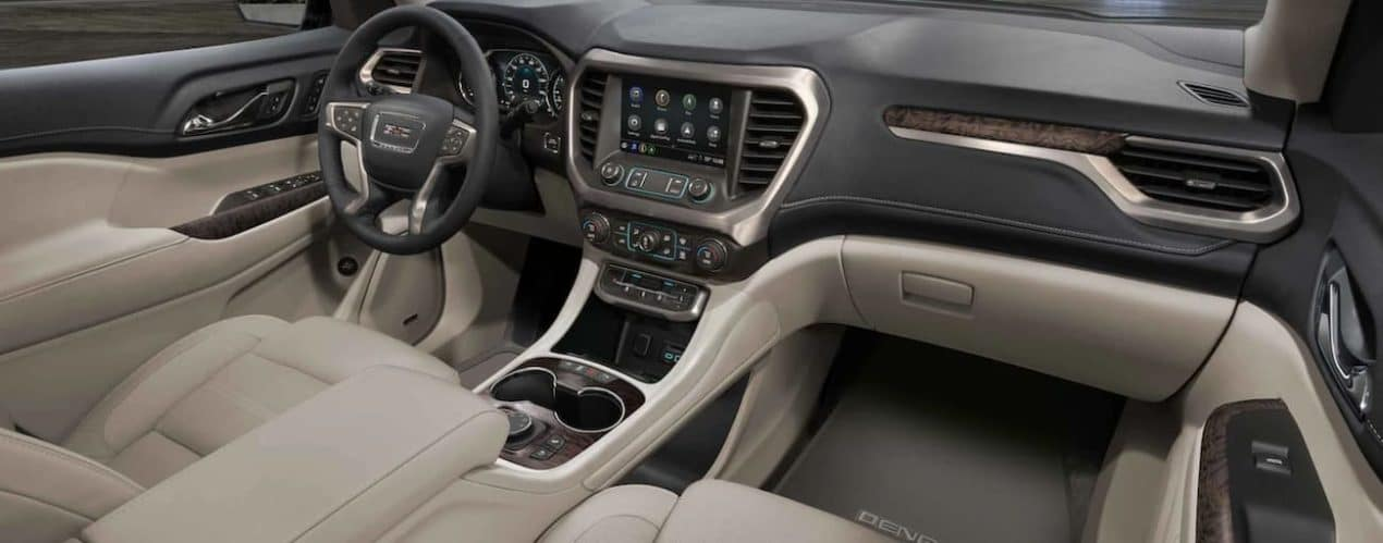 The beige interior of a 2021 GMC Acadia is shown.