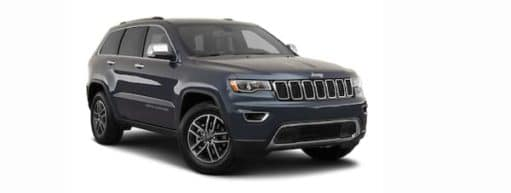 A dark blue 2021 Jeep Grand Cherokee is angled right.
