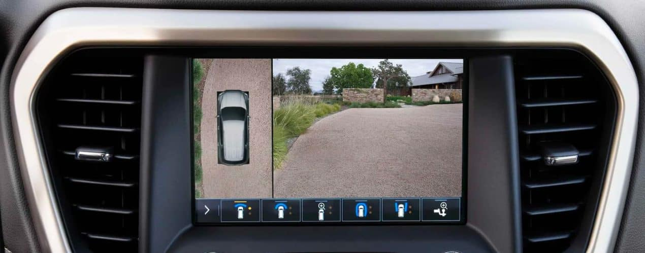 The back up camera view is shown on the infotainment screen in a 2021 GMC Acadia.