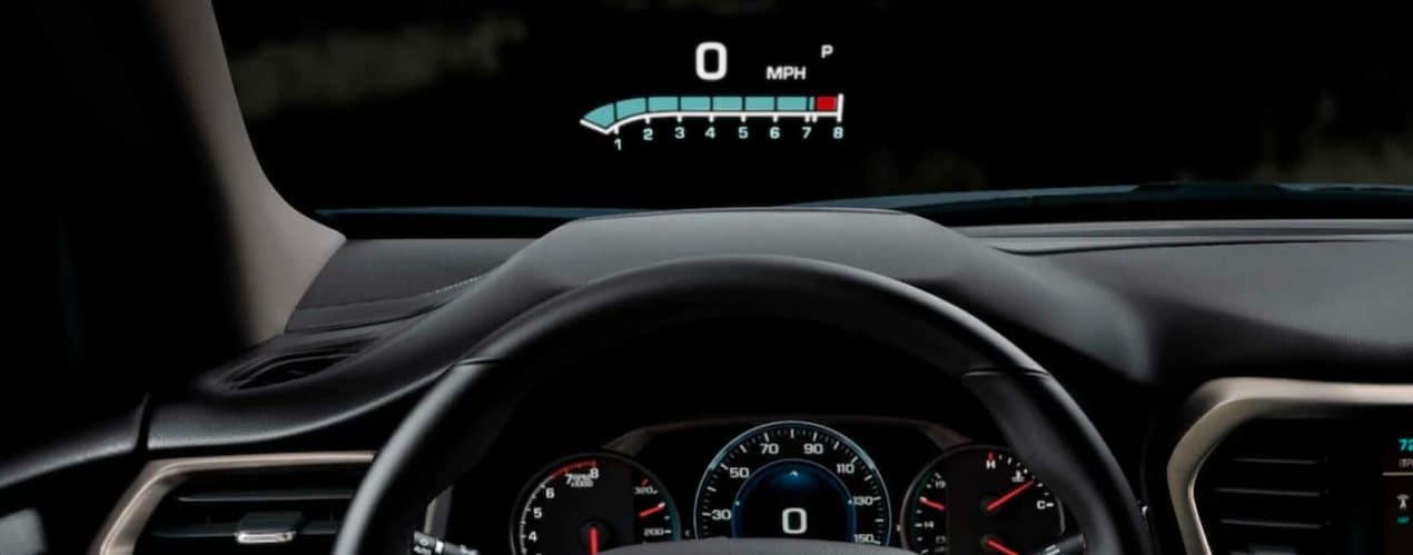 The HUD showing MPH is shown in a 2021 GMC Acadia.