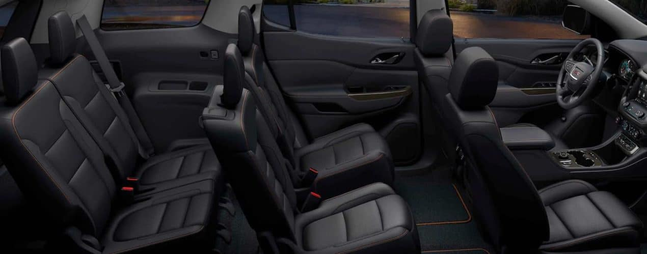 The black leather three row seating is shown in a 2021 GMC Acadia after winning the 2021 GMC Acadia vs 2021 Hyundai Palisade head to head.