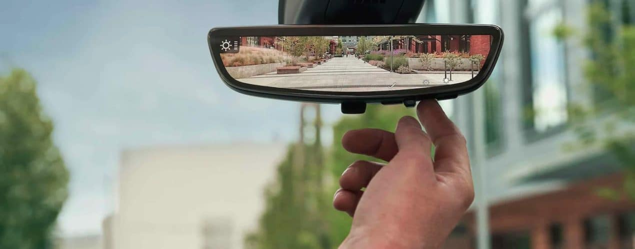 A close up shows the rearview mirror in a 2021 GMC Acadia Denali.