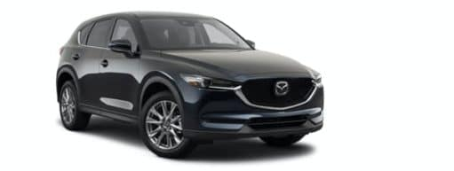 A black 2021 Mazda CX-5 Signature is angled right.