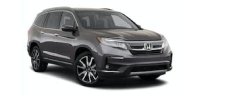 A grey 2021 Honda Pilot LX is angled right.