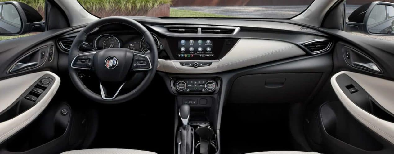 The interior of a 2022 Buick Encore GX shows the steering wheel and infotainment screen.