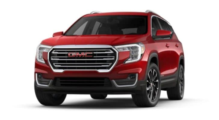 A red 2022 GMC Terrain is shown angled left.