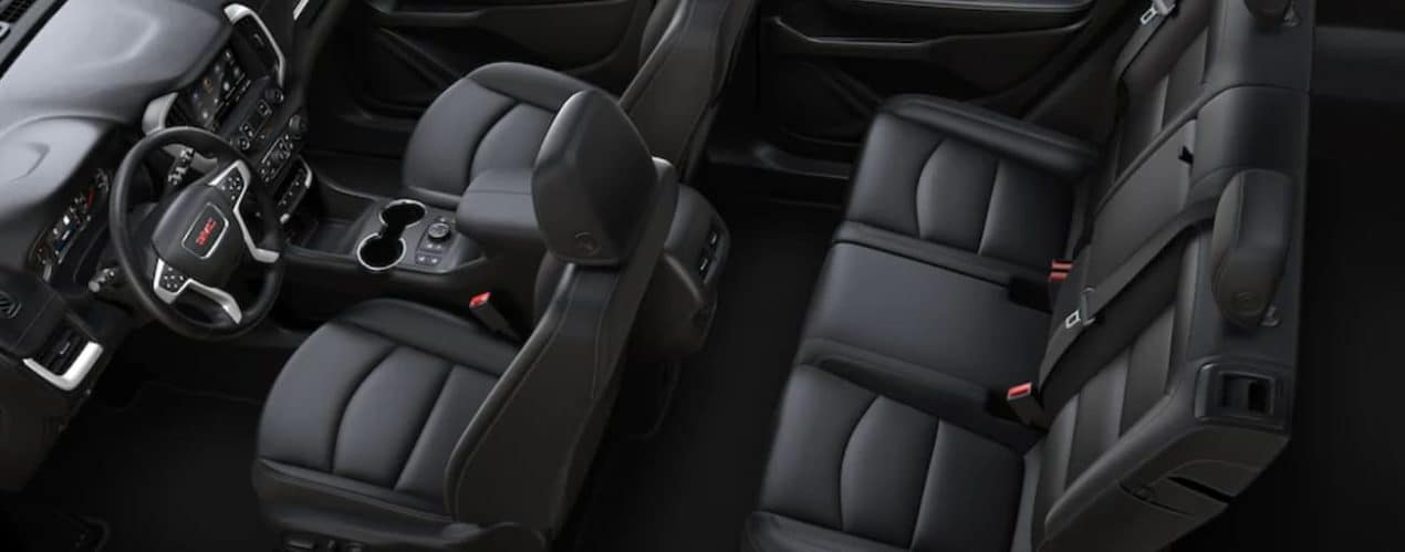 The black interior of a 2022 GMC Terrain shows two rows of seating.