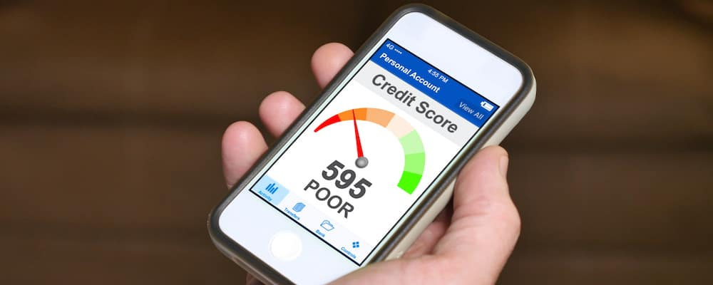 Smartphone showing a poor credit score rating