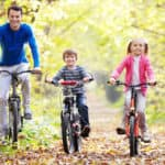 Family of 4 Biking Under Trees