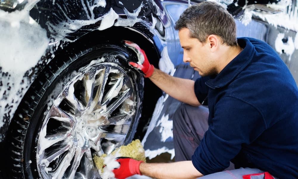 Man Polishing Wheels