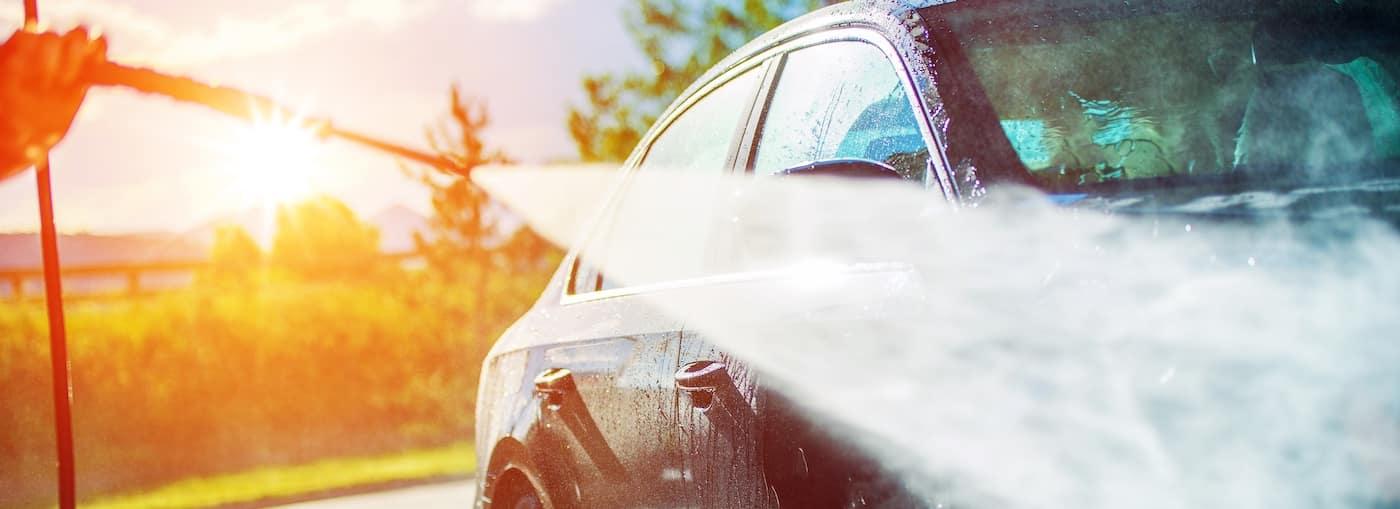 Washing Car with Hose