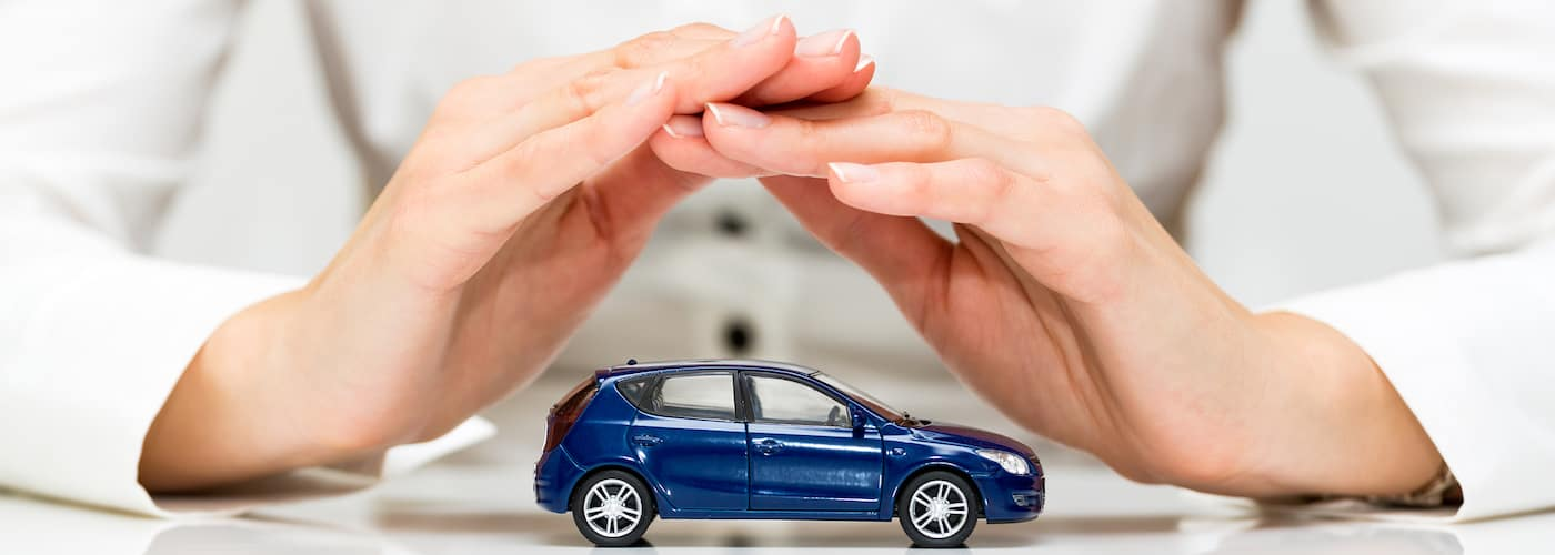 Hands Covering Car