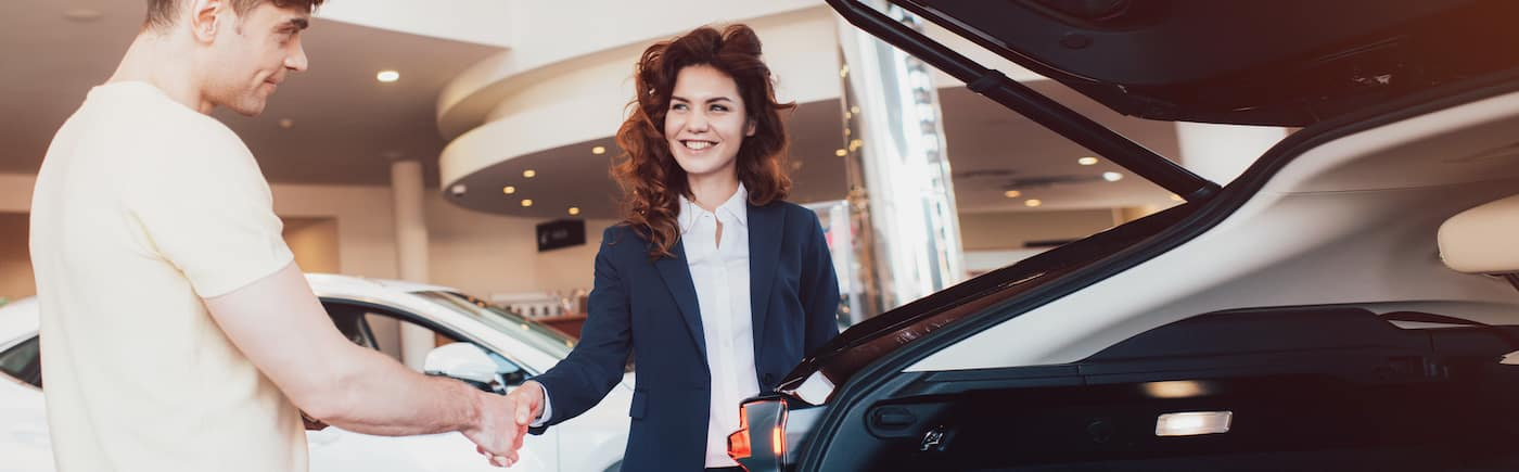 Man Buying Car from Woman