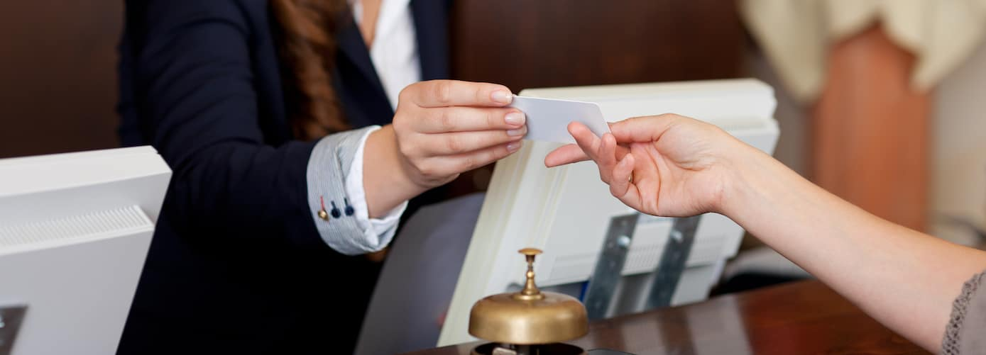 Front Desk Receptionist with Key Card