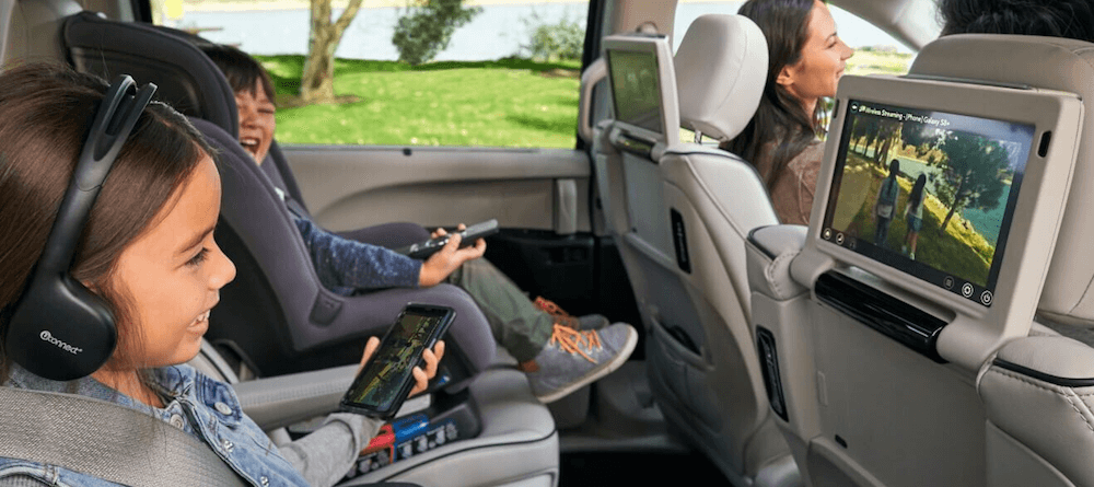 2020 Chrysler Pacifica back seat with child enjoying back seat entertainment