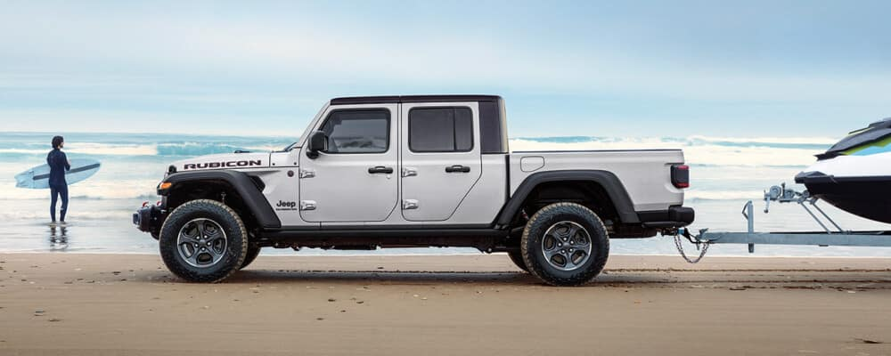 2021 Jeep Gladiator on the beach towing a boat