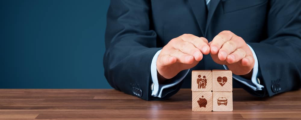 Insurance agent offering protection at a wooden desk