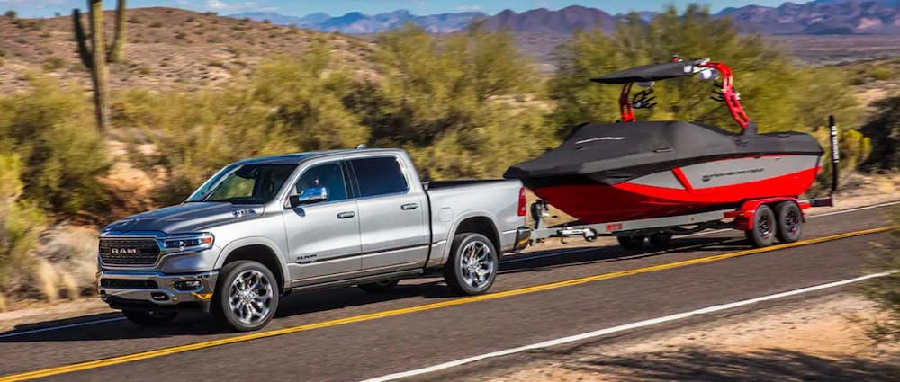 Silver 2019 RAM 1500 towing a boat
