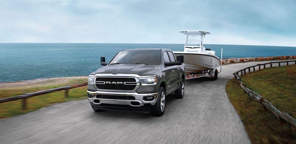 2020 RAM 1500 Towing a Boat Along a Lake