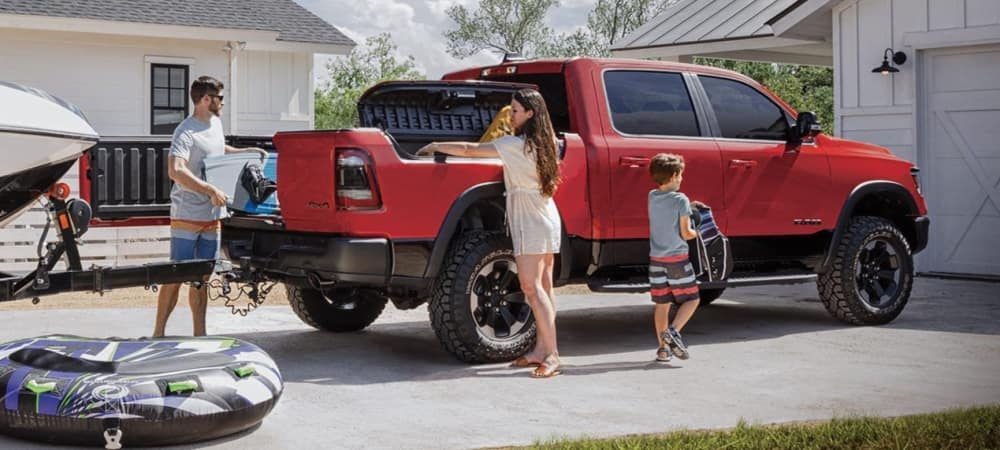 Family loading RAM 1500 Bed for Adventures.