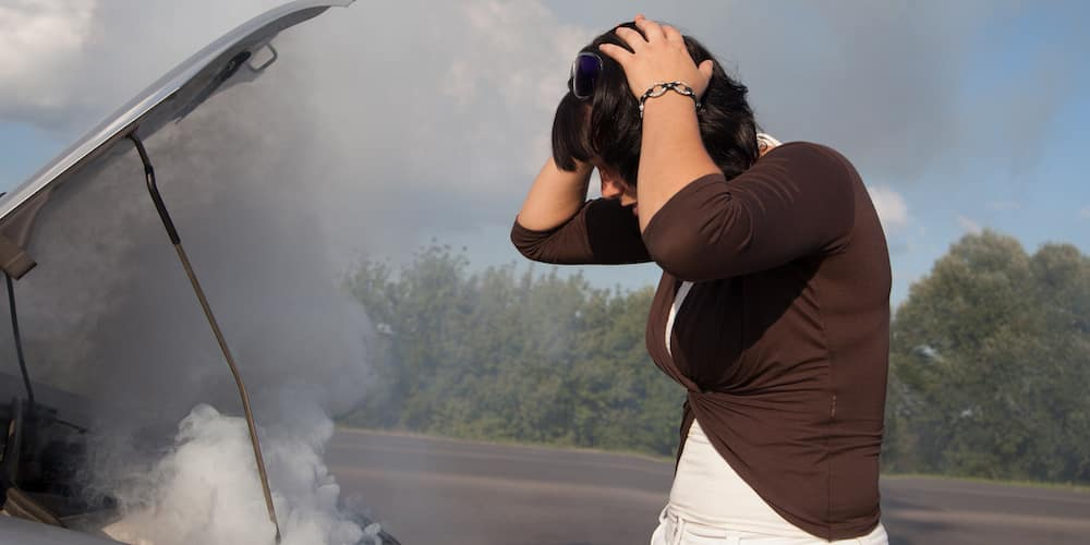 Woman Distraught Over Car Overheating