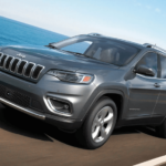 2021 Jeep Cherokee Towing Banner Showing Cherokee SUV towing boat on trailer