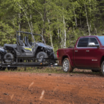 2021 RAM 1500 Trims Level Banner Towing Smaller Vehicles in Forest