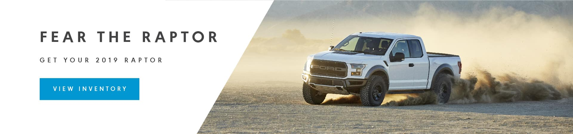 White 2019 Raptor rips up some dirt.