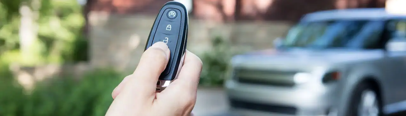 Hand Holding Ford Key Fob