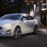 2020 Ford Fusion Titanium Trim Level parked in alley with string lights